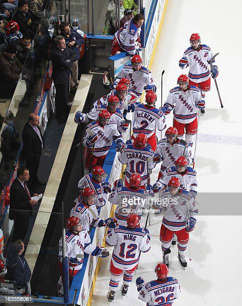 Evan McEneny of the Kitchener Rangers celebrates a goal with his teammates in an OHL game against the London Knights on March 3 2013 at the Budweiser...