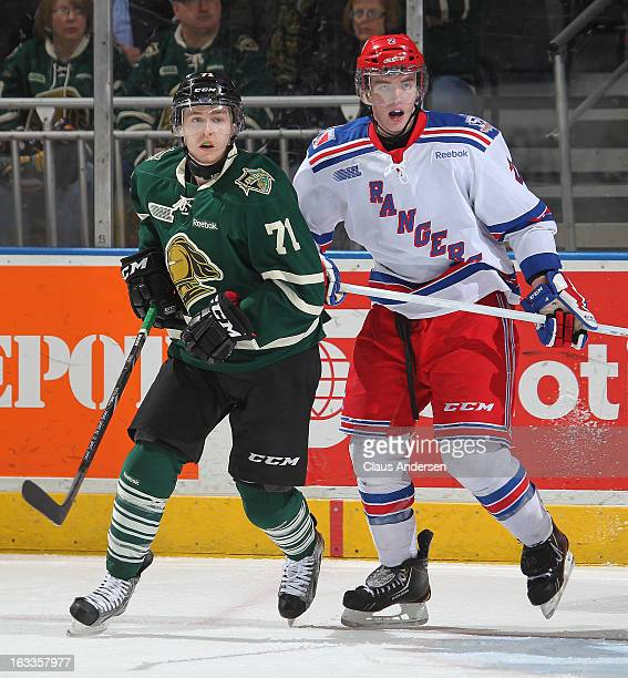 Evan McEneny of the Kitchener Rangers skates next to Chris Tierney of the London Knights in an OHL game on March 3 2013 at the Budweiser Gardens in...