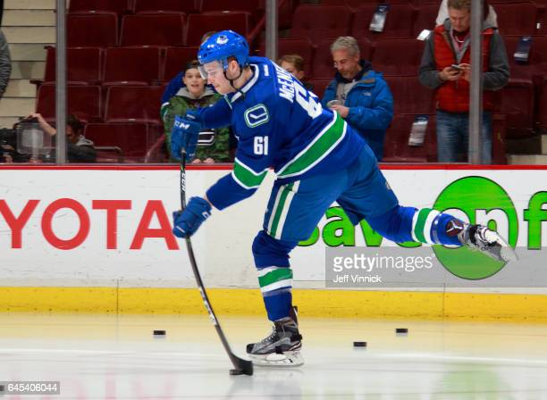 Evan McEneny of the Vancouver Canucks takes a shot during warmup before his NHL game against the San Jose Sharks at Rogers Arena February 25 2017 in...