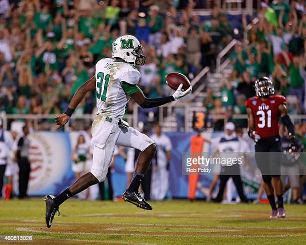 Evan McKelvey of the Marshall Thundering Herd scores a touchdown during the second half of the game against the Northern Illinois Huskies at FAU...