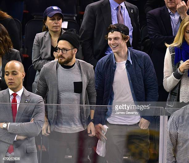 Evan Peters and guest attend the Pittsburgh Penguins vs New York Rangers playoff game at Madison Square Garden on April 16 2015 in New York City