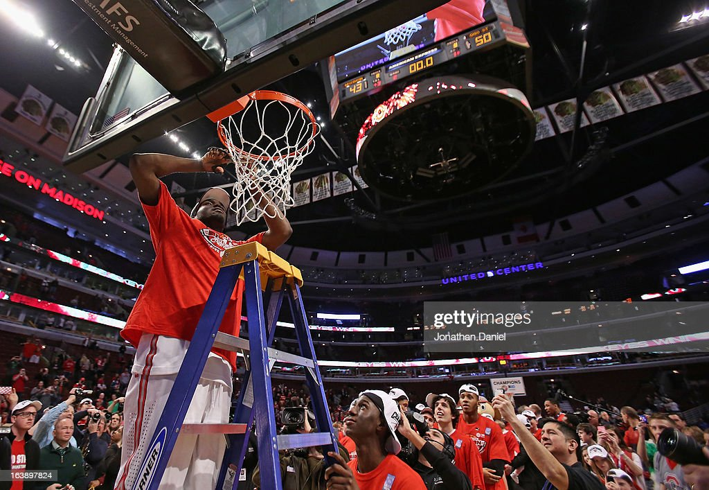Evan Ravenel #30 of the Ohio State Buckeyes cuts down the net after the Buckeyes defeated the Wisconsin Badgers during the Big Ten Basketball Tournament Championship game at United Center on March 17, 2013 in Chicago, Illinois. Ohio State defeats Wisconsin 50-43.