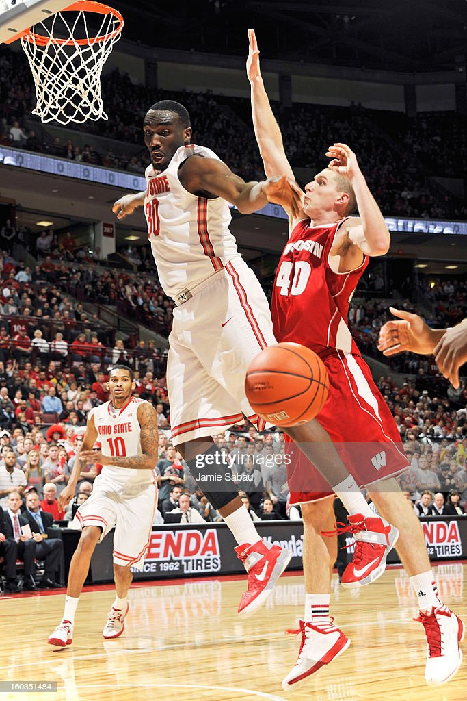 Evan Ravenel #30 of the Ohio State Buckeyes has the ball stripped away by Jared Berggren #40 of the Wisconsin Badgers in the second half on January 29, 2013 at Value City Arena in Columbus, Ohio. Ohio State defeated Wisconsin 58-49.