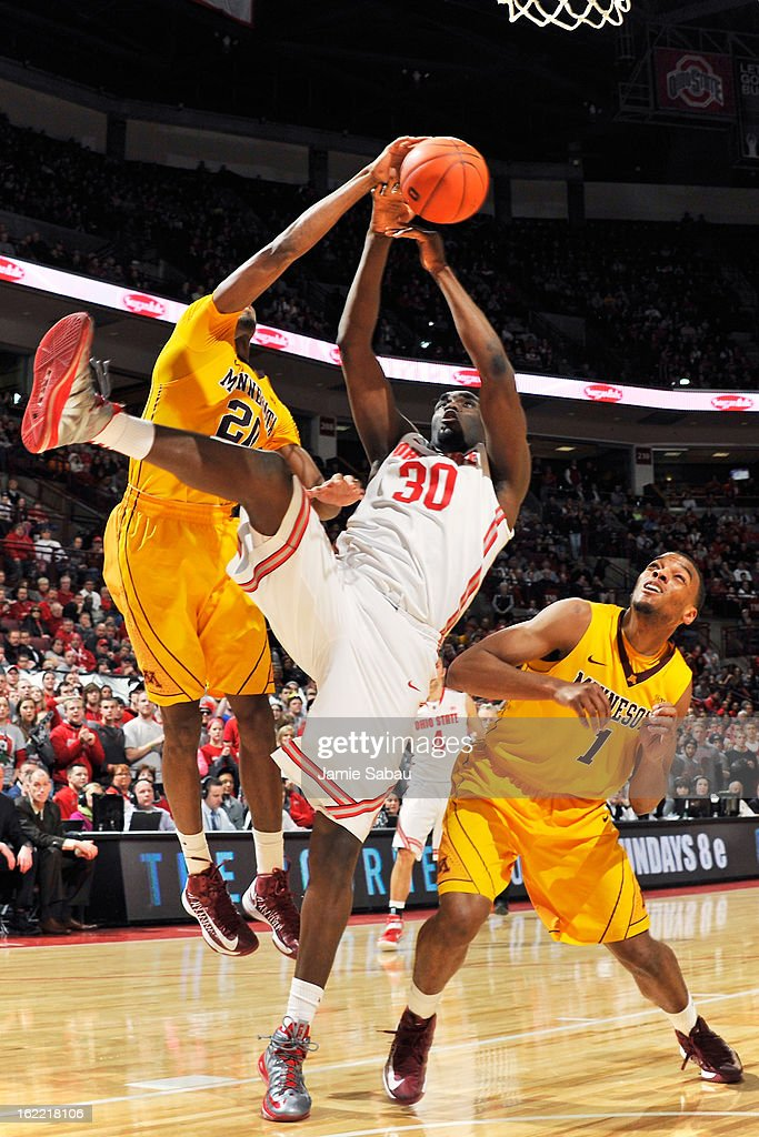 Evan Ravenel #30 of the Ohio State Buckeyes is fouled as he attempts to shoot in the second half as Austin Hollins #20 and Andre Hollins #1 of the Minnesota Golden Gophers defend on February 20, 2013 at Value City Arena in Columbus, Ohio. Ohio State defeated Minnesota 71-45.