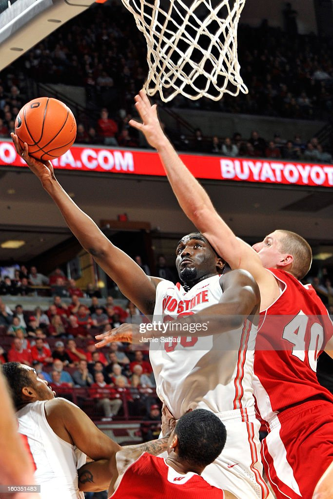 Evan Ravenel #30 of the Ohio State Buckeyes lays in two points past the defense of Jared Berggren #40 of the Wisconsin Badgers in the second half on January 29, 2013 at Value City Arena in Columbus, Ohio. Ohio State defeated Wisconsin 58-49.