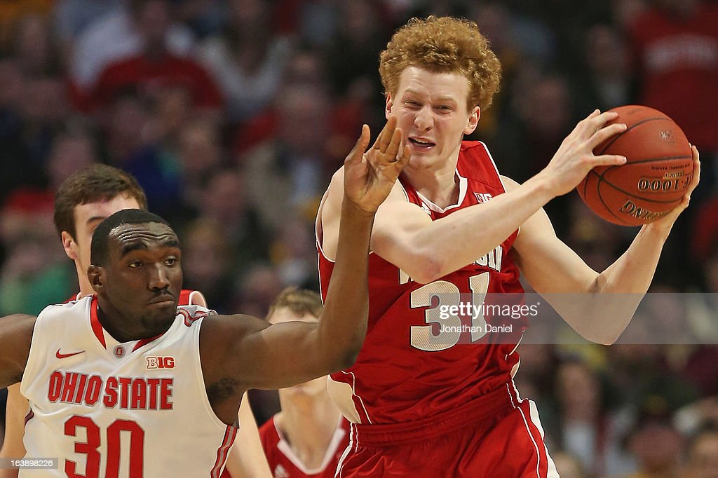 Evan Ravenel #30 of the Ohio State Buckeyes puts pressure on Mike Bruesewitz #31 of the Wisconsin Badgers during the Big Ten Basketball Tournament Championship game at United Center on March 17, 2013 in Chicago, Illinois. Ohio State defeats Wisconsin 50-43.