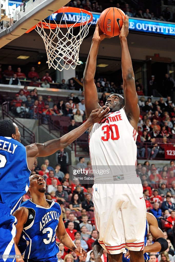 Evan Ravenel #30 of the Ohio State Buckeyes slams home two points in the first half against the UNC Asheville Bulldogs on December 15, 2012 at Value City Arena in Columbus, Ohio.