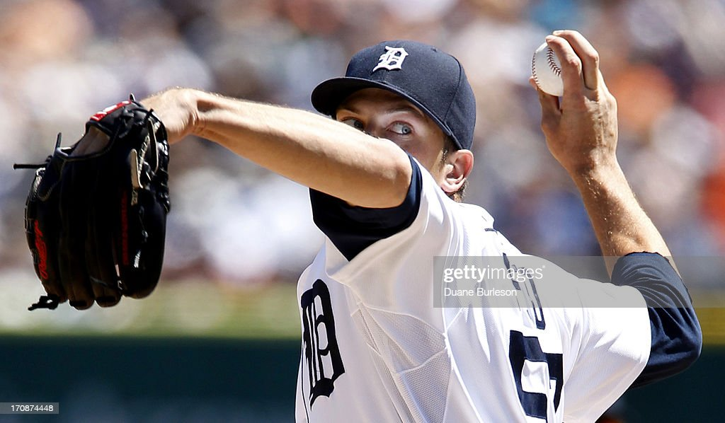 Evan Reed #57 of the Detroit Tigers pitches against the Baltimore Orioles in the seventh inning at Comerica Park on June 19, 2013 in Detroit, Michigan.
