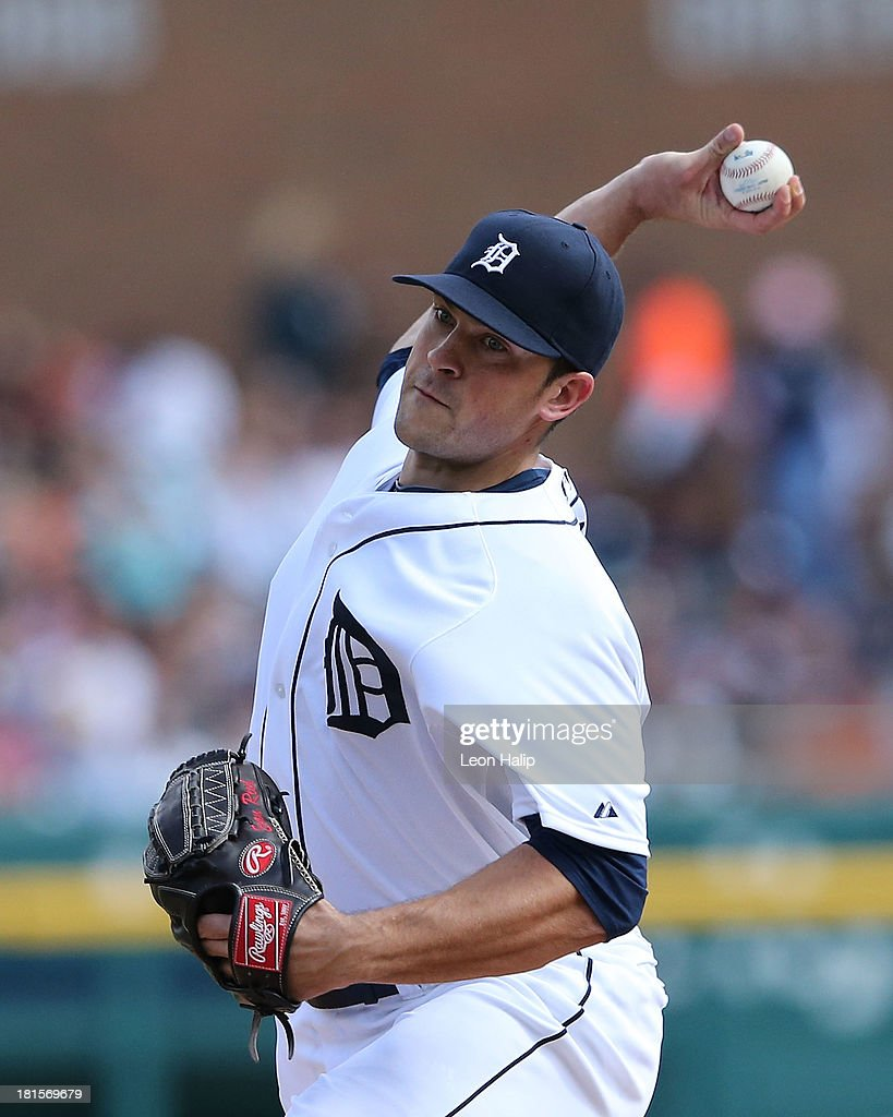 Evan Reed #57 of the Detroit Tigers pitches in the seventh inning of the game against the Chicago White Sox at Comerica Park on September 22, 2013 in Detroit, Michigan.