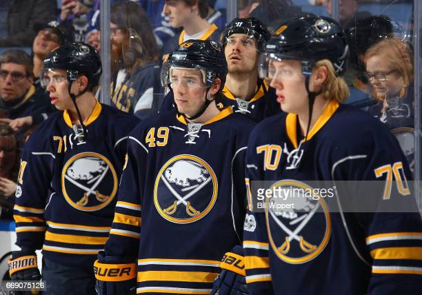 Evan Rodrigues CJ Smith and Alexander Nylander of the Buffalo Sabres skate in warmups prior to an NHL game against the Toronto Maple Leafs at the...