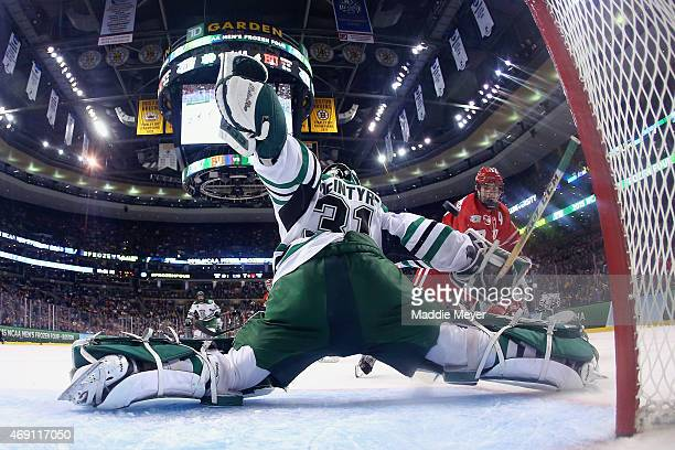 Evan Rodrigues of the Boston University Terriers takes a shot against Zane McIntyre of the North Dakota during the third period of the 2015 NCAA...