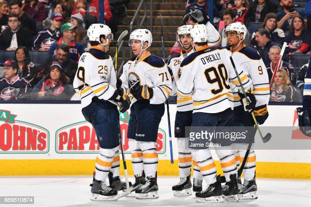 Evan Rodrigues of the Buffalo Sabres celebrates his second period goal with his fellow teammates during a game against the Columbus Blue Jackets on...