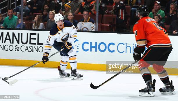 Evan Rodrigues of the Buffalo Sabres skates with the puck against Cam Fowler of the Anaheim Ducks during the game on March 17 2017 at Honda Center in...