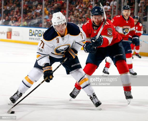 Evan Rodrigues of the Buffalo Sabres skates with the puck against Jonathan Huberdeau of the Florida Panthers at the BBT Center on April 8 2017 in...