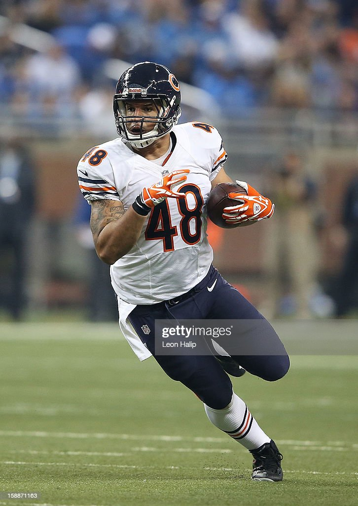 Evan Rodriguez #48 of the Chicago Bears runs for a short gain during the game against the Detroit Lions at Ford Field on December 30, 2012 in Detroit, Michigan. The Bears defeted the Lions 26-24.