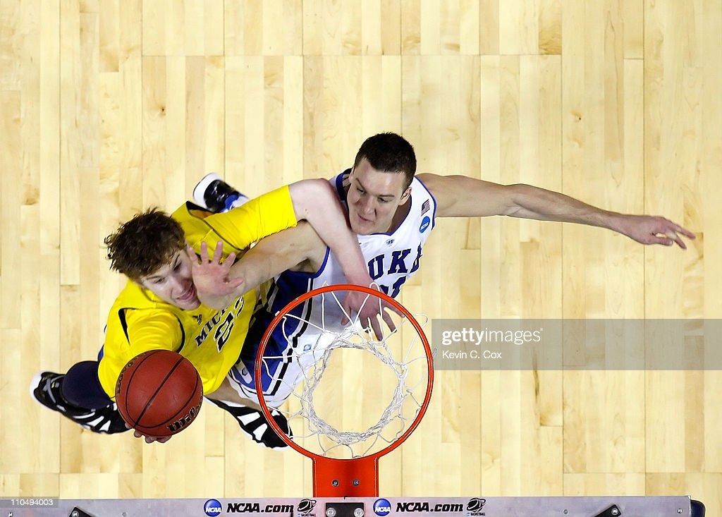 Evan Smotrycz #23 of the Michigan Wolverines goes up for a layup against Miles Plumlee #21 of the Duke Blue Devils during the third round of the 2011 NCAA men's basketball tournament at Time Warner Cable Arena on March 20, 2011 in Charlotte, North Carolina.
