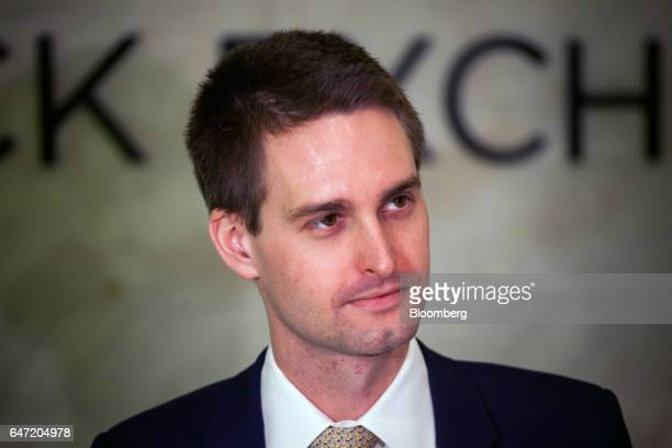 Evan Spiegel cofounder and chief executive officer of Snap Inc stands on the floor of the New York Stock Exchange during the company's initial public...