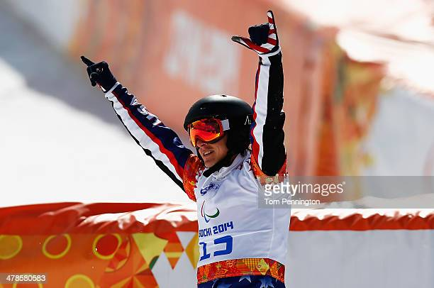 Evan Strong of the United States celebrates winning the gold medal during the Men's Para Snowboard Cross Standing on day seven of the Sochi 2014...