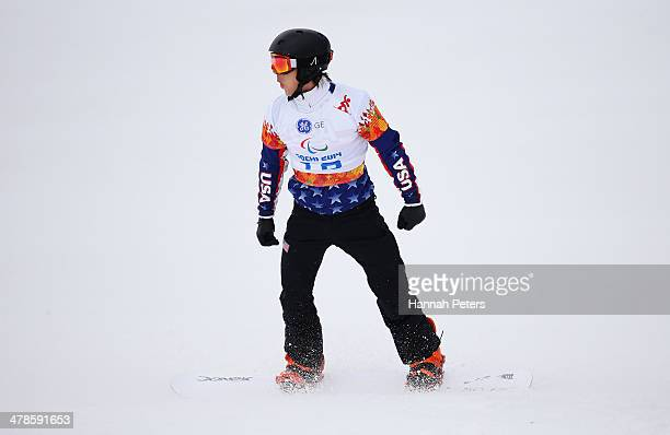 Evan Strong of the United States reacts during the Men's Para Snowboard Cross Standing on day seven of the Sochi 2014 Paralympic Winter Games at Rosa...