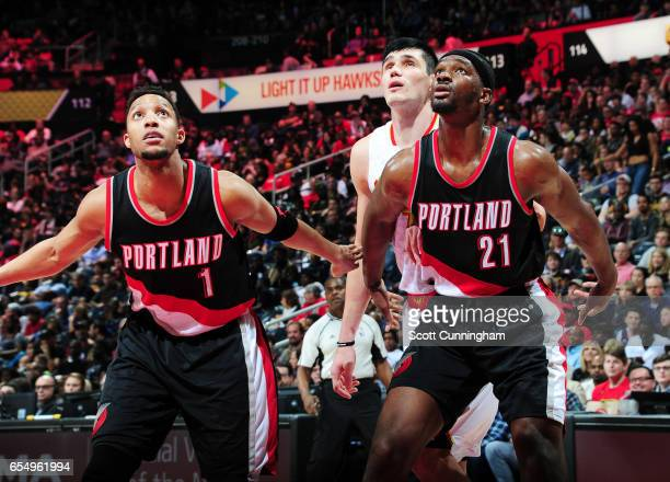 Evan Turner and Noah Vonleh of the Portland Trail Blazers play defense against Ersan Ilyasova of the Atlanta Hawksduring the game on March 18 2017 at...