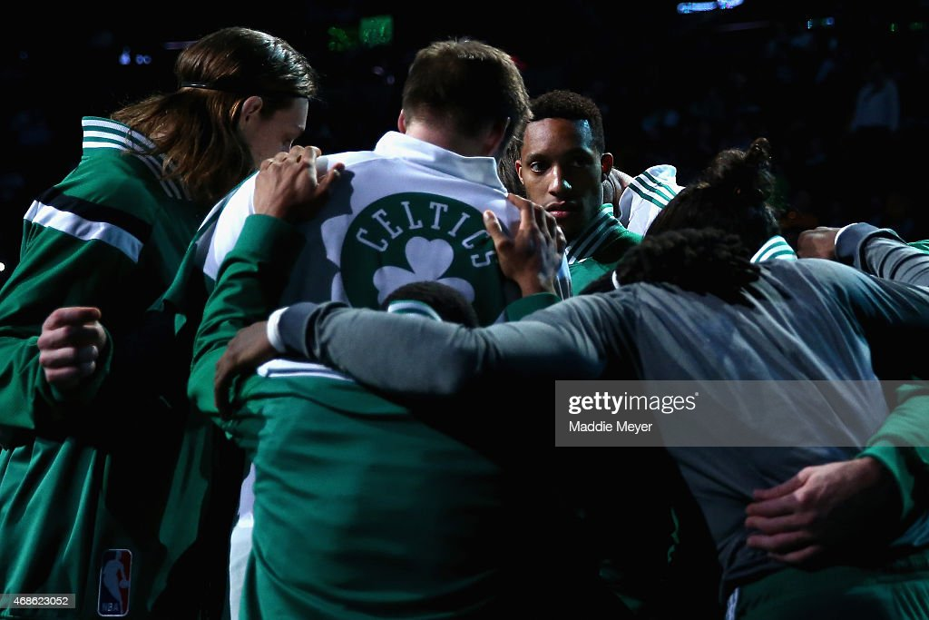 Evan Turner #11 of the Boston Celtics, center, looks on from the huddle before the game against the Indiana Pacers at TD Garden on April 1, 2015 in Boston, Massachusetts.