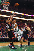 Evan Turner of the Boston Celtics draws a foul from DeMar DeRozan of the Toronto Raptors during the third quarter at TD Garden on March 23 2016 in...