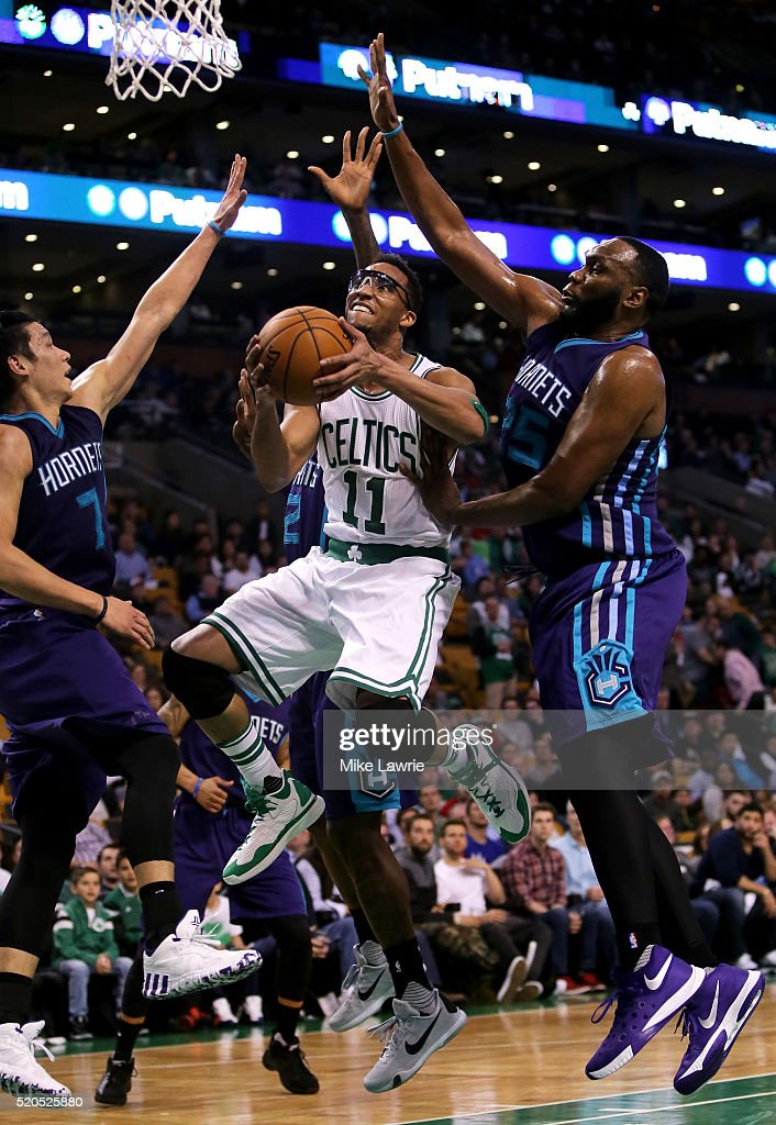 Evan Turner #11 of the Boston Celtics drives to the basket against Jeremy Lin #7 and Al Jefferson #25 of the Charlotte Hornets in the fourth quarter at TD Garden on April 11, 2016 in Boston, Massachusetts.