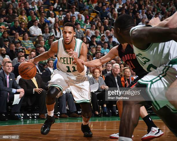 Evan Turner of the Boston Celtics drives to the basket against the Toronto Raptors during the game on April 14 2015 at the TD Garden in Boston...