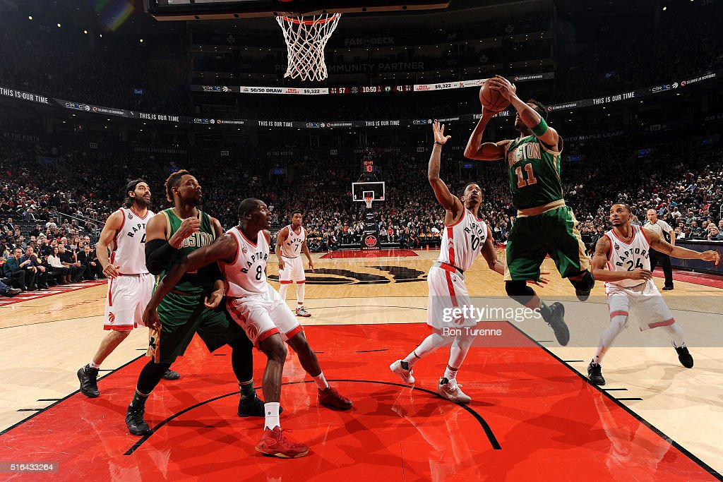 Evan Turner #11 of the Boston Celtics goes for the layup during the game against the Toronto Raptors on March 18, 2016 at the Air Canada Centre in Toronto, Ontario, Canada.