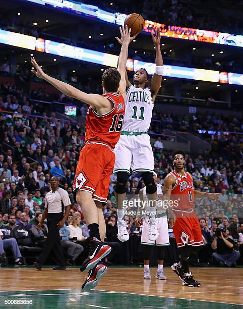 Evan Turner of the Boston Celtics hits a shot over Pau Gasol of the Chicago Bulls during the second quarter at TD Garden on December 9 2015 in Boston...