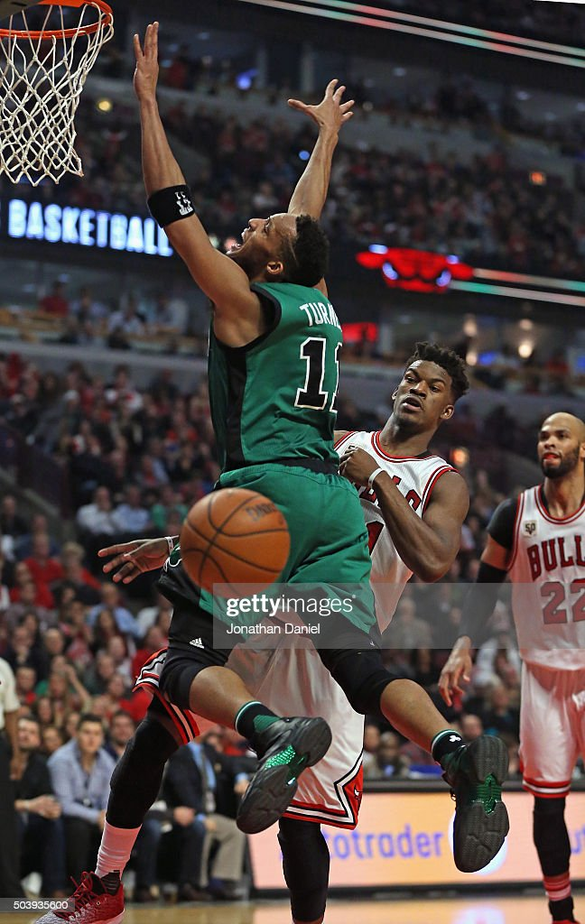 <a gi-track='captionPersonalityLinkClicked' href=/galleries/search?phrase=Evan+Turner&family=editorial&specificpeople=4665764 ng-click='$event.stopPropagation()'>Evan Turner</a> #11 of the Boston Celtics looses control of the ball after it was knocked away by <a gi-track='captionPersonalityLinkClicked' href=/galleries/search?phrase=Jimmy+Butler+-+Basketball+Player&family=editorial&specificpeople=9860567 ng-click='$event.stopPropagation()'>Jimmy Butler</a> #21 of the Chicago Bulls at the United Center on January 7, 2016 in Chicago, Illinois. The Bulls defeated the Celtics 101-92.