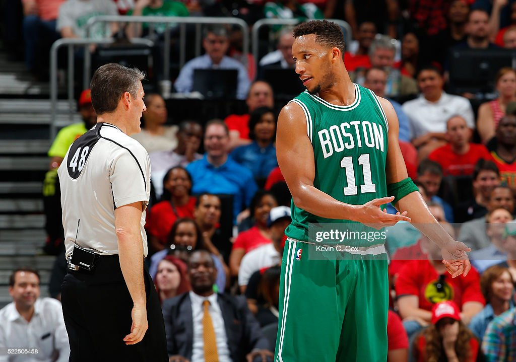 Evan Turner of the Boston Celtics questions a foul charged to Isaiah Thomas with referee Scott Foster in Game Two of the Eastern Conference...