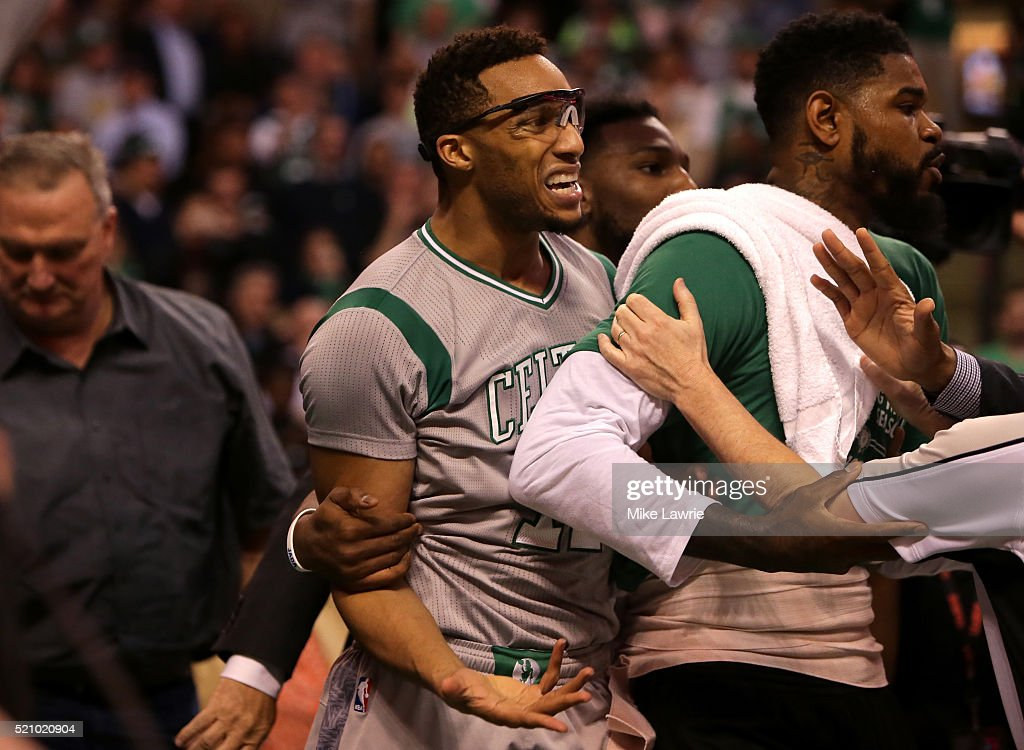 Evan Turner of the Boston Celtics reacts at the end of the third quarter against the Miami Heat as players from both teams receive technical fouls at...