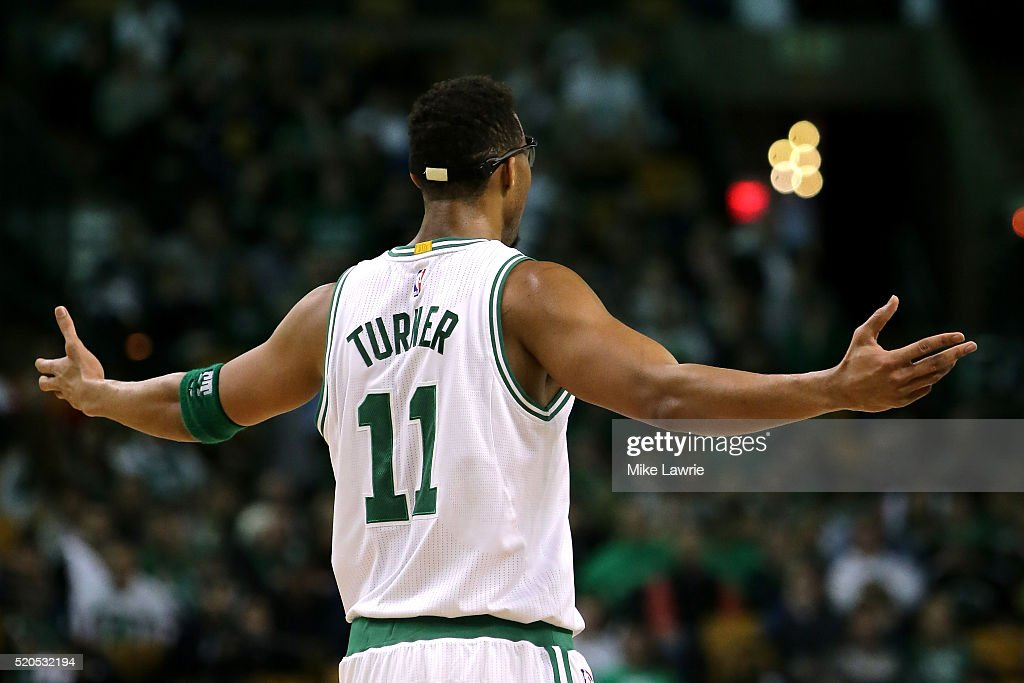 Evan Turner #11 of the Boston Celtics reacts to a foul call in the fourth quarter against the Charlotte Hornets at TD Garden on April 11, 2016 in Boston, Massachusetts.