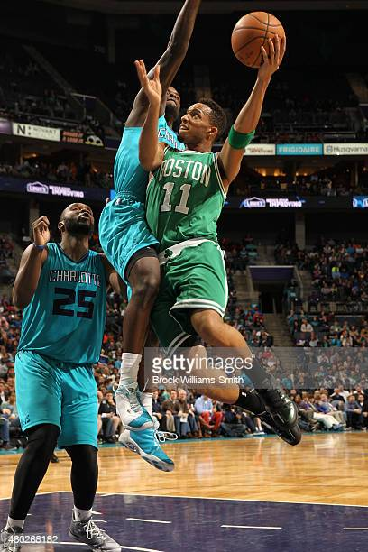 Evan Turner of the Boston Celtics takes a shot against the Charlotte Hornets at the Time Warner Cable Arena on December 10 2014 in Charlotte North...