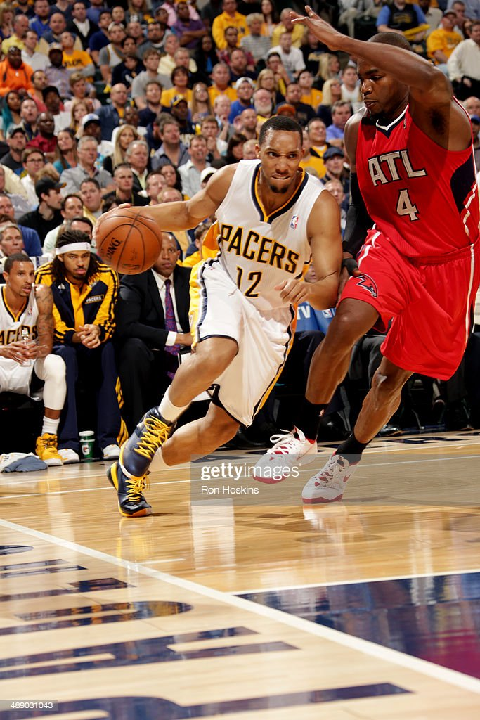 <a gi-track='captionPersonalityLinkClicked' href=/galleries/search?phrase=Evan+Turner&family=editorial&specificpeople=4665764 ng-click='$event.stopPropagation()'>Evan Turner</a> #12 of the Indiana Pacers drives against <a gi-track='captionPersonalityLinkClicked' href=/galleries/search?phrase=Paul+Millsap&family=editorial&specificpeople=880017 ng-click='$event.stopPropagation()'>Paul Millsap</a> #4 of the Atlanta Hawks in Game Five of the East Conference Quarter Finals of the 2014 NBA playoffs at Bankers Life Fieldhouse on April 28, 2014 in Indianapolis, Indiana.