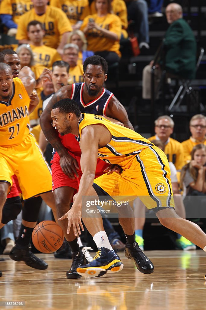 <a gi-track='captionPersonalityLinkClicked' href=/galleries/search?phrase=Evan+Turner&family=editorial&specificpeople=4665764 ng-click='$event.stopPropagation()'>Evan Turner</a> #12 of the Indiana Pacers drives to the basket during Game One of the Eastern Conference Semifinals against the Washington Wizards on May 5, 2014 at Bankers Life Fieldhouse in Indianapolis, Indiana.