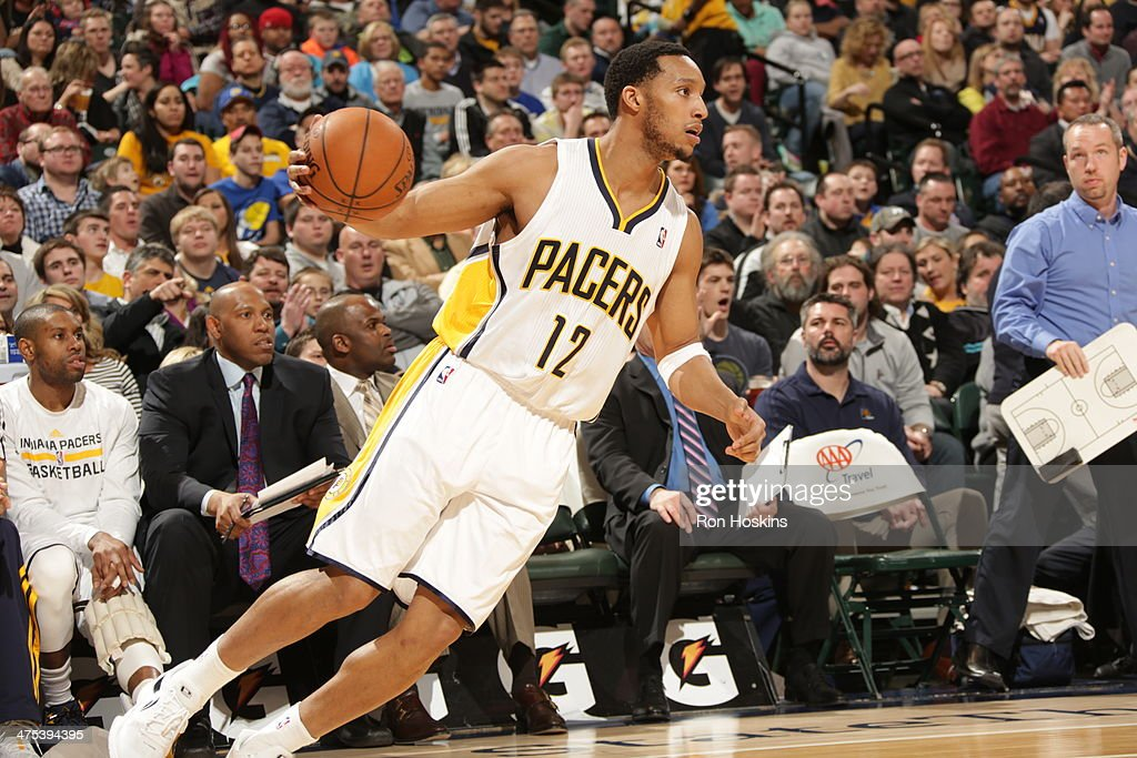 <a gi-track='captionPersonalityLinkClicked' href=/galleries/search?phrase=Evan+Turner&family=editorial&specificpeople=4665764 ng-click='$event.stopPropagation()'>Evan Turner</a> #12 of the Indiana Pacers handles the ball during a game against the Milwaukee Bucks at Bankers Life Fieldhouse on February 25, 2014 in Indianapolis, Indiana.