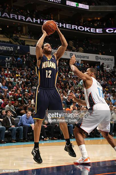 Evan Turner of the Indiana Pacers shoots the ball against the Charlotte Bobcats at the Time Warner Cable Arena on March 5 2014 in Charlotte North...