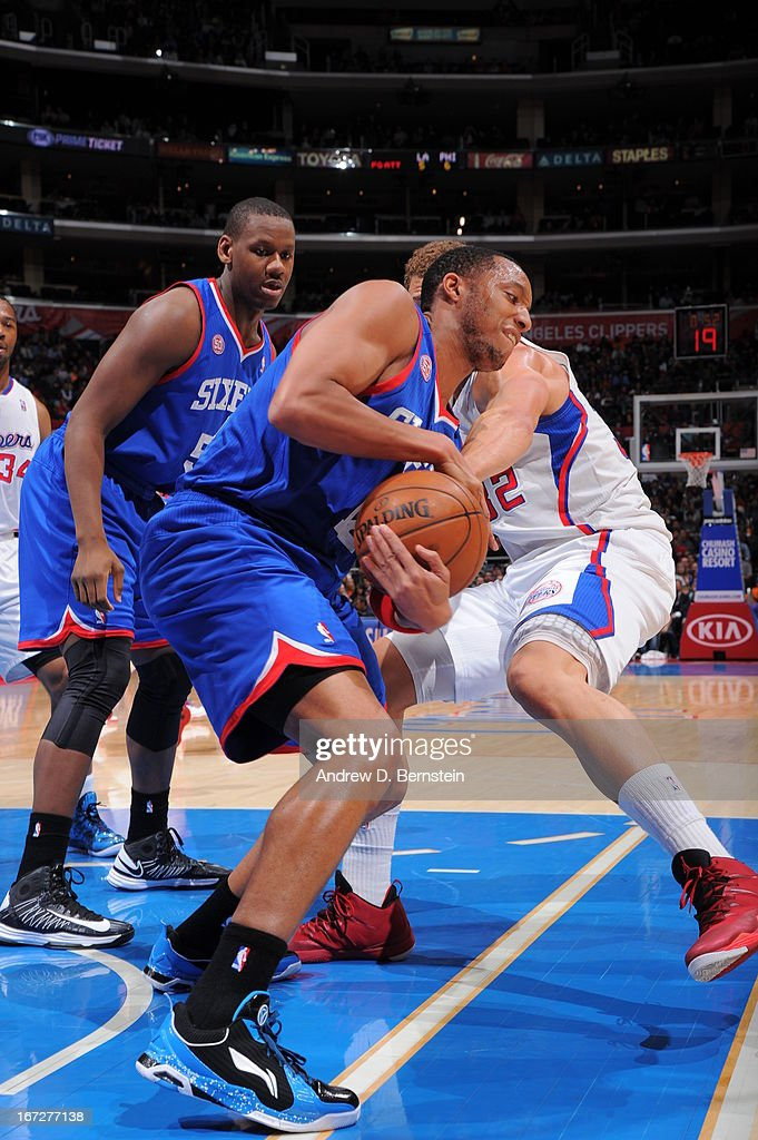 Evan Turner #12 of the Philadelphia 76ers and Blake Griffin #32 of the Los Angeles Clippers fight for a ball at Staples Center on March 20, 2013 in Los Angeles, California.