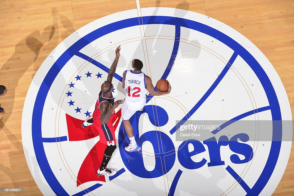 <a gi-track='captionPersonalityLinkClicked' href=/galleries/search?phrase=Evan+Turner&family=editorial&specificpeople=4665764 ng-click='$event.stopPropagation()'>Evan Turner</a> #12 of the Philadelphia 76ers dribbles the ball against the Washington Wizards on November 6, 2013 in Philadelphia, Pennsylvania.