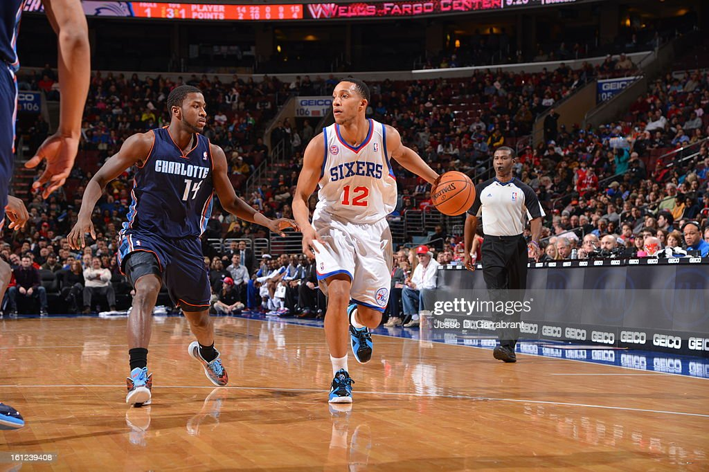 Evan Turner #12 of the Philadelphia 76ers dribbles to the basket against Michael Kidd-Gilchrist #14 of the Charlotte Bobcats during the game at the Wells Fargo Center on February 9, 2013 in Philadelphia, Pennsylvania.