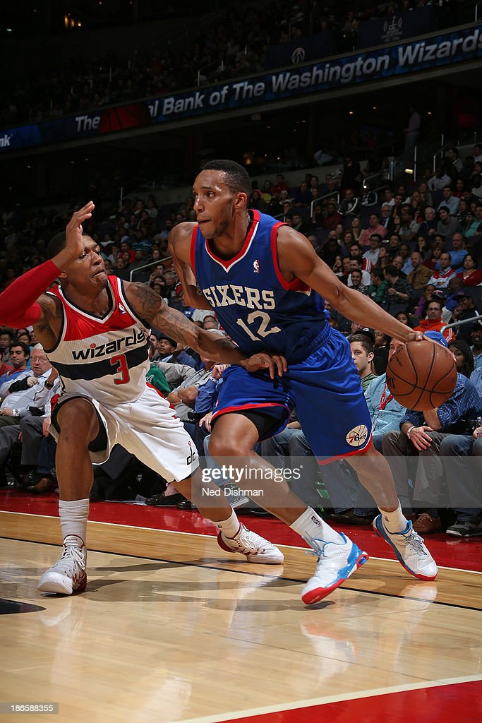 <a gi-track='captionPersonalityLinkClicked' href=/galleries/search?phrase=Evan+Turner&family=editorial&specificpeople=4665764 ng-click='$event.stopPropagation()'>Evan Turner</a> #12 of the Philadelphia 76ers drives against <a gi-track='captionPersonalityLinkClicked' href=/galleries/search?phrase=Bradley+Beal&family=editorial&specificpeople=7640439 ng-click='$event.stopPropagation()'>Bradley Beal</a> #3 of the Washington Wizards during the game at the Verizon Center on November 1, 2013 in Washington, DC.