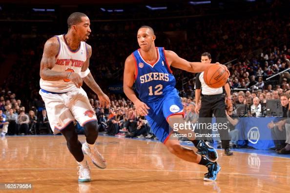Evan Turner of the Philadelphia 76ers drives against JR Smith of the New York Knicks on February 24 2013 at Madison Square Garden in New York City...