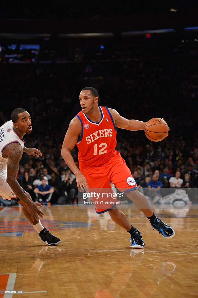 Evan Turner #12 of the Philadelphia 76ers drives to the basket against J.R. Smith #8 of the New York Knicks on November 4, 2012 at Madison Square Garden in New York City.