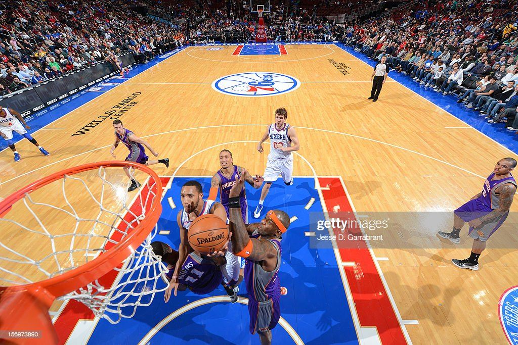 Evan Turner #12 of the Philadelphia 76ers drives to the basket against the Phoenix Suns at the Wells Fargo Center on November 25, 2012 in Philadelphia, Pennsylvania.