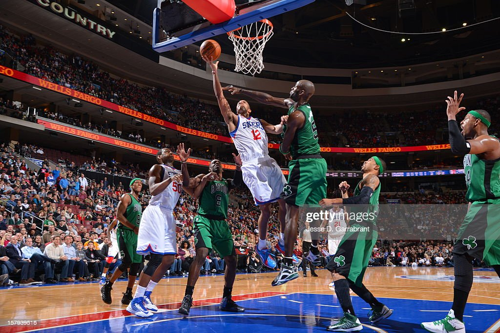 Evan Turner #12 of the Philadelphia 76ers drives to the basket against Kevin Garnett #5 of the Boston Celtics at the Wells Fargo Center on December 7, 2012 in Philadelphia, Pennsylvania.