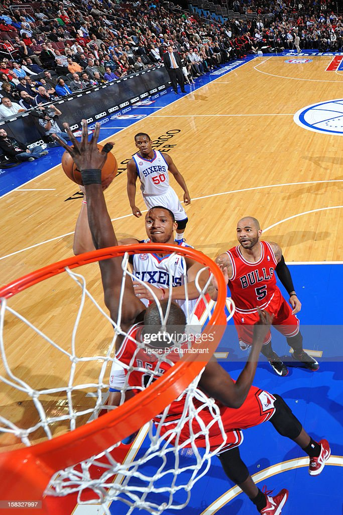Evan Turner #12 of the Philadelphia 76ers drives to the basket against the Chicago Bulls on December 12, 2012 at the Wells Fargo Center in Philadelphia, Pennsylvania.