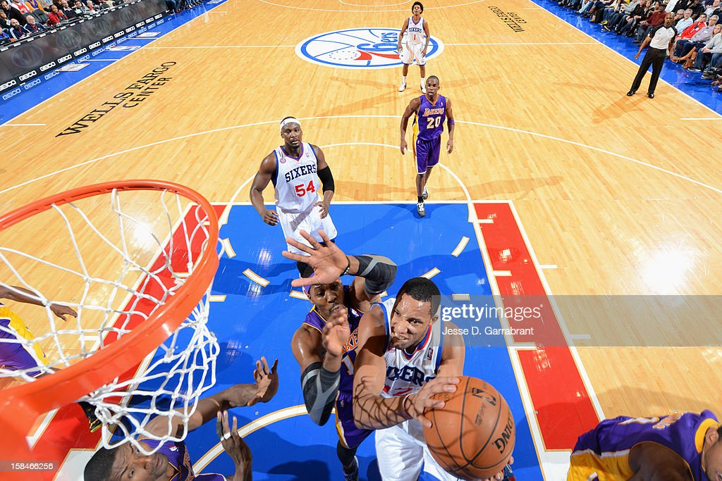 <a gi-track='captionPersonalityLinkClicked' href=/galleries/search?phrase=Evan+Turner&family=editorial&specificpeople=4665764 ng-click='$event.stopPropagation()'>Evan Turner</a> #12 of the Philadelphia 76ers drives to the basket against <a gi-track='captionPersonalityLinkClicked' href=/galleries/search?phrase=Dwight+Howard&family=editorial&specificpeople=201570 ng-click='$event.stopPropagation()'>Dwight Howard</a> #12 of the Los Angeles Lakers on December 16, 2012 at the Wells Fargo Center in Philadelphia, Pennsylvania.