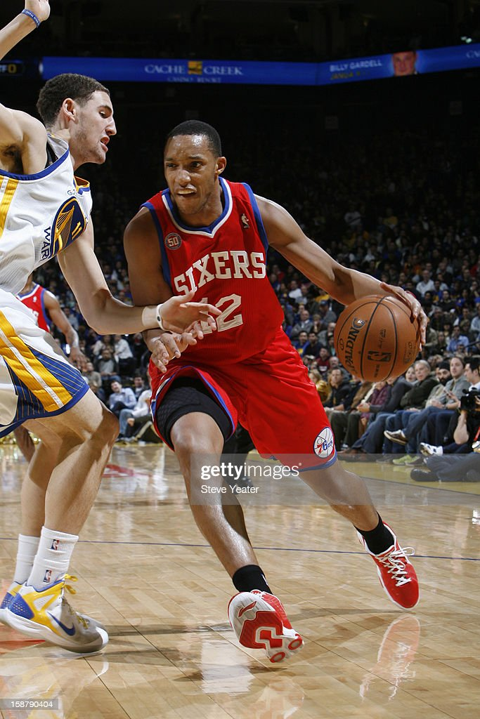 <a gi-track='captionPersonalityLinkClicked' href=/galleries/search?phrase=Evan+Turner&family=editorial&specificpeople=4665764 ng-click='$event.stopPropagation()'>Evan Turner</a> #12 of the Philadelphia 76ers drives to the basket against <a gi-track='captionPersonalityLinkClicked' href=/galleries/search?phrase=Klay+Thompson&family=editorial&specificpeople=5132325 ng-click='$event.stopPropagation()'>Klay Thompson</a> #11 of the Golden State Warriors on December 28, 2012 at Oracle Arena in Oakland, California.